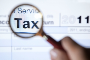 Magnifying glass over the word tax on form 1040